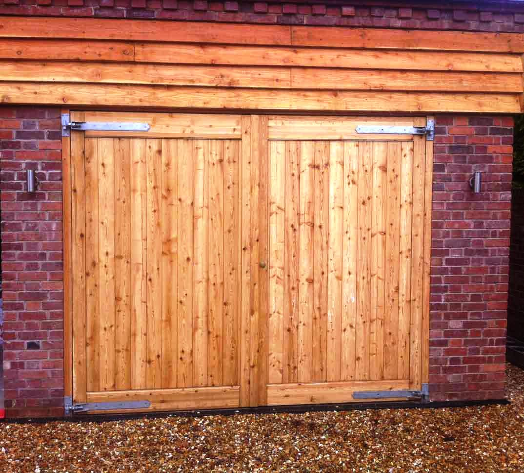 Wooden Garage Doors Cost Schmidt Gallery Design